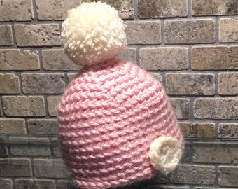 Crocheted baby hat with pom pom