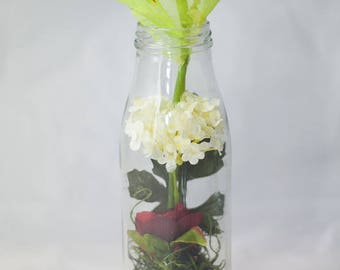 Milkbottle with pink ranunculus