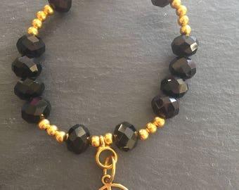 Peace charm bracelet with black beads