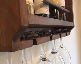 Wine rack, rustic holds four bottles and four glasses.