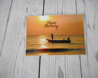 Charming male birthday card with beautiful sunset and men fishing.