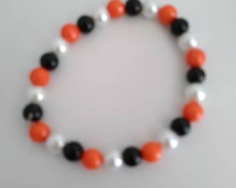 Orange black and silver glass bead bracelet