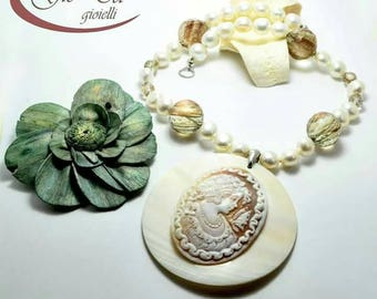 Handmade necklace in sterling silver, freshwater pearls, stones of Sun, shell and cameo