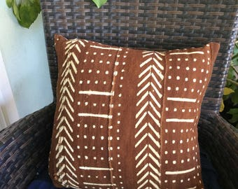 Rust color mudcloth pillow