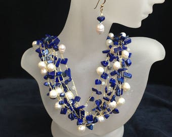 Eclipse: 6 strands necklace and earrings with lapis lazuli, 4mm swarovski crystals and fresh water pearls.