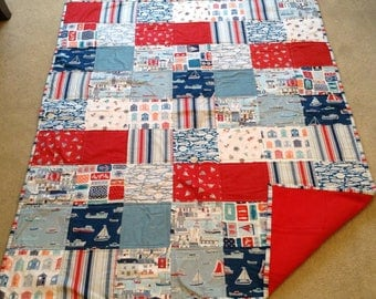 "Harbourside Lap Quilt.  47""x38"" Red fleece backing."