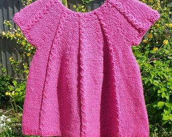 Sweet knitted pink baby dress