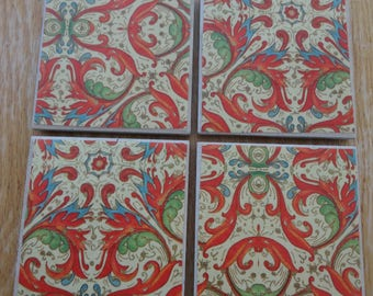 Set of 4 tile coasters, oranges and reds