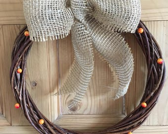 Rattan handmade wreath with summer berries and burlap bow
