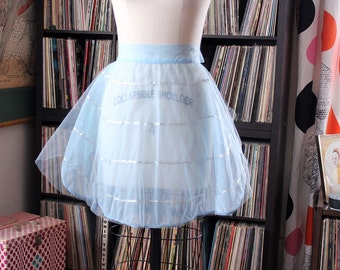 vintage sheer blue apron with silver rickrack trim and tulle under layer . vintage half apron
