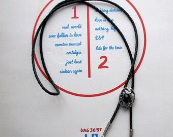 black and silver southwestern bolo tie . filgree floral bolo necklace