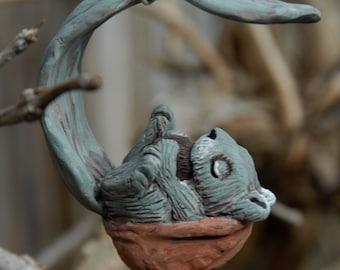 sleeping grey squirrel ornament