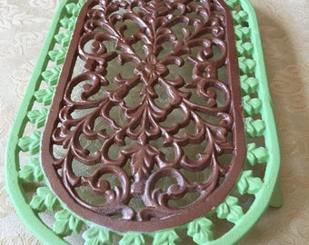 Cast Iron Oval Trivet Copper and Apple Green Hand Painted High Heat Paint Footed Vintage Trivet Fleur d' Lis Pattern Scrolled Iron