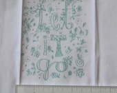 embroidery pattern on fabric Let It Go, turquoise on white