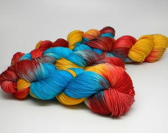 Macaw on HipHop Monkey fingering weight hand painted sock yarn scarlet gold turquoise blue variagated