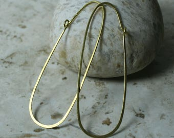 Handmade hammered extra large gold tone enlongated oval hoop, one pair (item ID GT120G18)