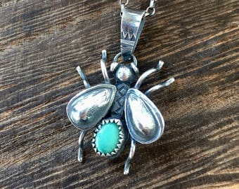 Little 'bug'. Sterling silver handmade 'bug' with kingston mine turquoise. With or without a chain options.