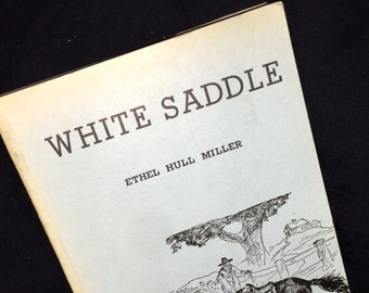 Hard-to-Find White Saddle Paper Back Book