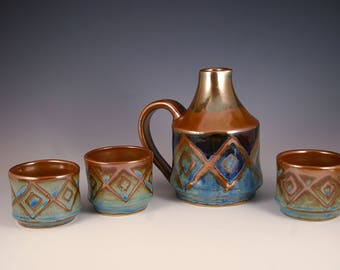 Sake set, decanter,  pitcher with 3 cups in brown and blue