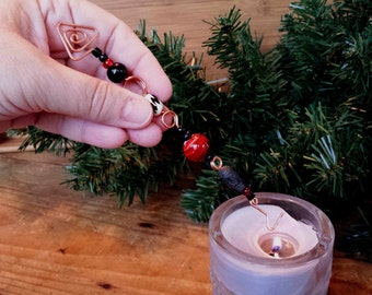 copper candle snuffer christmas ornament one of a kind beaded suncatcher handcrafted with red and black and white glass