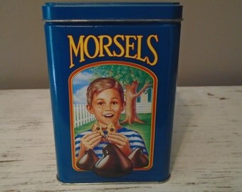 Blue tin from Nestles Tollhouse Morsels with three different scenes, no rust