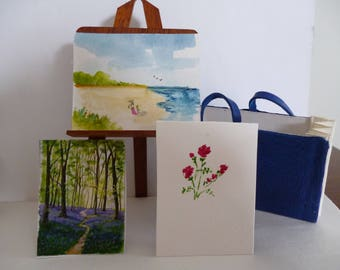 A one 12th scale miniature artists'portfolio ,complete with three paintings!!