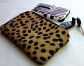 Cheetah print clutch with leather wristlet strap