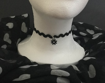 Handmade black zig zag ribbon choker with a small black flower.