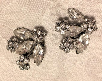 Vintage Signed Schreiner Earrings In Flower Design of Clear Rhinestones Set In Silver Colored Metal. They are About 1 1/4 Inches Long. (D10)
