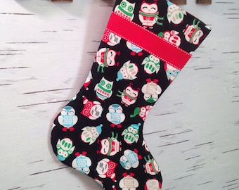 Owls in Sweaters on Black Christmas Stocking with Red Ribbon and Lining