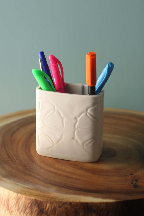 white pen holder