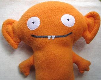 Plush monster, soft alien fantasy creature in orange fleece, 12 inches
