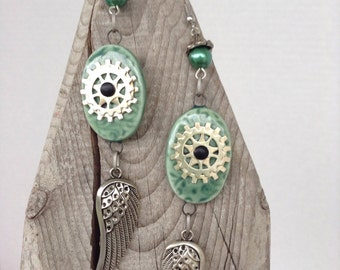 Green ceramic, gear and wing earrings