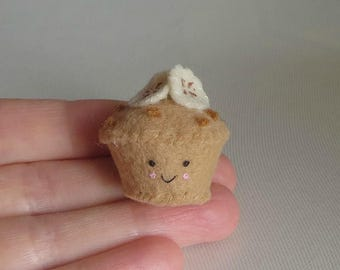 Banana nut muffin miniature felt plush with smling face stuffed toy with sliced bananas and nuts on top