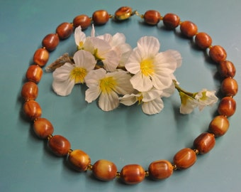 Flamy swirled collectible vintage 1950s unused flamy swirled tested opaqoe oval brown/ butter yellow tested bakelite necklace