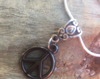 Peace necklace with silver plated snack chain