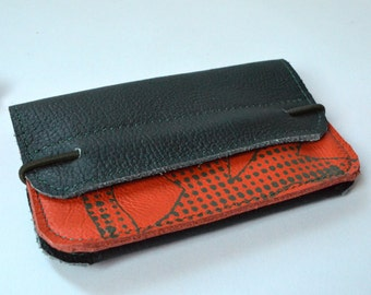 Wallet of orange and green leather with a print