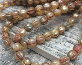Czech Glass Melon beads 6mm. One unit has 25 beads. Color: champagne forest