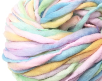 Handspun super bulky yarn, 53 yards and 3 ounces, 86 grams, spun super chunky, thick and thin in pastel rainbow  merino wool
