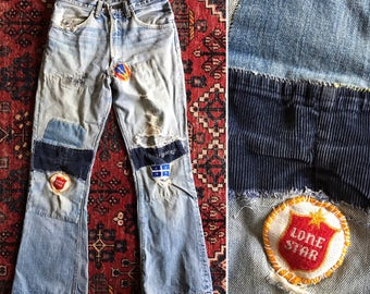 Vintage 70s LEVIS patched repaired faded jeans / Orange tab flares / Distressed thrashed jeans / 28 HIGH waist x 28 inseam