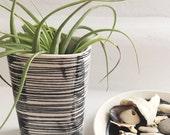 medium porcelain planter screen printed lines pattern in black.