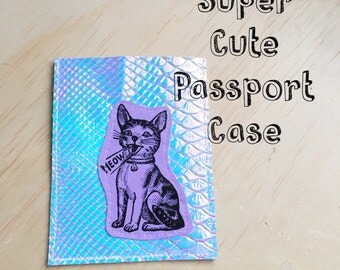 The Cutest Cat Passport Case made with holographic iridescent snakeskin fabric thats also Vegan