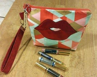 LipSense distributors wristlet bag, purse, pouch, orange, gold, teal  holds  21 lipsticks and additional supplies