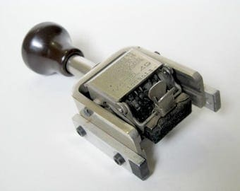Vintage Stamp - Numbering Machine
