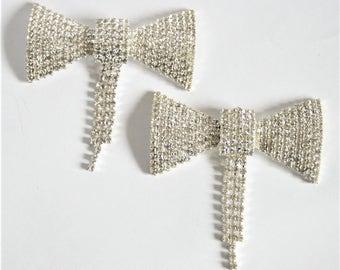 Vintage crystal dress clips. Bow dress clips.  Rhinestone shoe clips