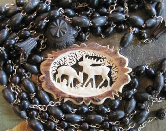 Hand Carved Deer and Rosary Beads