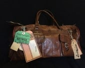 Vintage 1960s flight crew leather carry on holdall with various original airline luggage tags