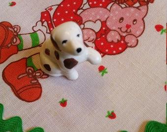 tiny spotted dog figurine