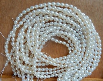 4-5mm  White,rice freshwater pearls , FULL STRAND (16 inches)