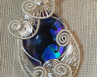 Wire wrapped pendant with hand painted glass cabochon with unicorn